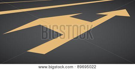 Orange arrow show left and straight on black asphalt road.