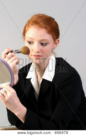Business Woman Applying Makeup