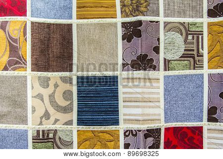 background texture of a patchwork of different pieces of fabric in the bazaar