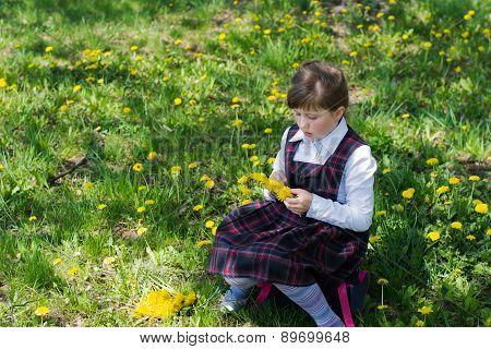 Kid Weaves A Wreath Of Dandelions
