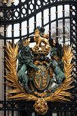 stock photo of royal palace  - Royal Crest at Buckingham Palace Gate in London United Kingdom - JPG