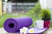 picture of yoga mat  - yoga mat and a cup of coffee - JPG