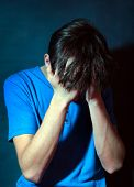 foto of sorrow  - Toned Photo of the Sorrowful Teenager in the Dark Room - JPG