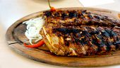 picture of spare  - spare ribs in wooden plate with vegetables - JPG