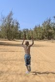 stock photo of ten  - Afro boy running in the sand - JPG