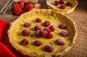 picture of berries  - Lemon tart with rosemary and berries filled with cream topped berries - JPG