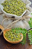 pic of chickpea  - Chickpea varieties in a burlap bag on a wooden background - JPG
