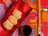 image of siomai  - steamed shrimp dumplings served on a traditional bamboo place mat - JPG