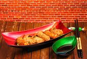 foto of deep  - traditional Vietnam deep fried shrimp and pork rolls in breadcrumbs served on a wood table top - JPG
