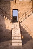 foto of bannister  - Detail take of a staircase climbing to the battlements of a castle - JPG