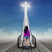 picture of gates heaven  - Backside of female teenager standing on the wooden floor while looking at a stair to the heaven - JPG