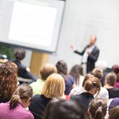 stock photo of entrepreneurship  - Speaker Giving a Talk at Business Meeting - JPG