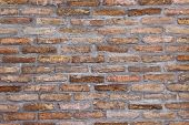 stock photo of brick block  - Background pattern of weathered old brick wall texture grungy rusty brushed blocks as urban architecture backdrop - JPG