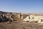 image of chimney rock  - The landscape of Cappadocia with rock formations at sunny autumn day - JPG