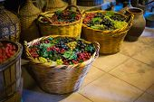 picture of wine cellar  - Baskets with the colorful Grapes in old wine cellar in monastery in Meteora Greece - JPG