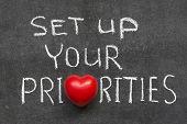 foto of priorities  - set up your priorities phrase handwritten on blackboard with heart symbol instead of O - JPG