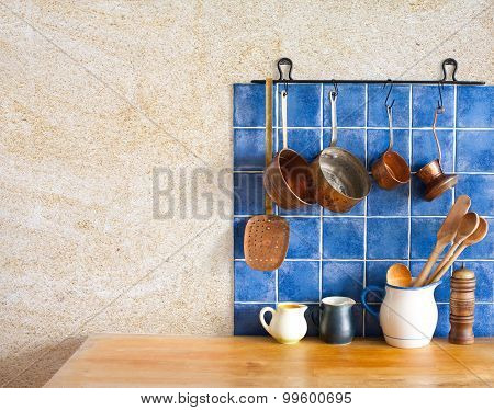 Kitchen Interior. Hanging Retro Design Copper Kitchenware Set. Pots, Stewpots, Coffee Maker, Spoon,