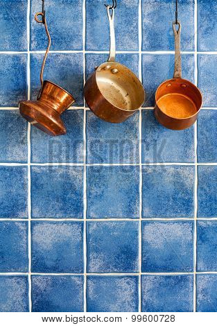 Pot, Stewpot, Coffee Maker Hanging On. Hanging Retro Design Copper Kitchenware Set.