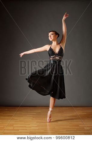 Young ballerina in black costume