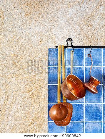 Kitchen Interior With Kitchen Accessories. Hanging Retro Design Copper Kitchenware Set.