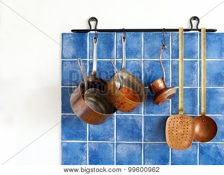Kitchen Appliances. Hanging Retro Design Copper Kitchenware Set.