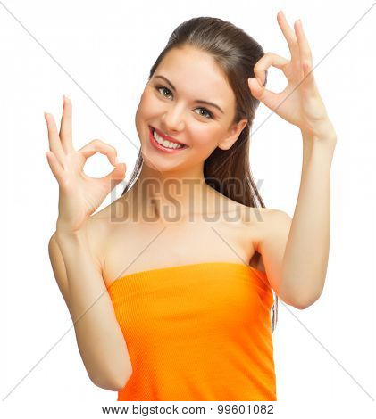 Young girl shows ok gesture isolated