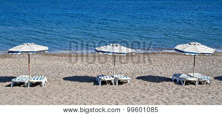 Greece. Kos Island. Kefalos Beach. Chairs And Umbrellas