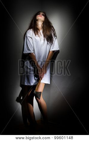 Young zombie girl with axe