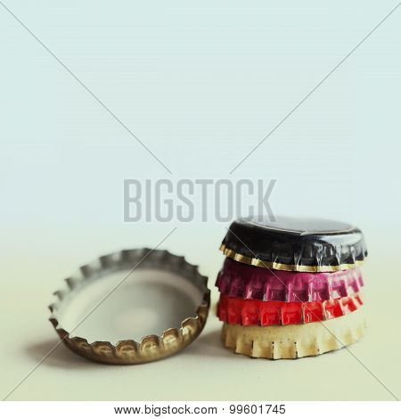 Retro Bottle Caps On Pastel Background
