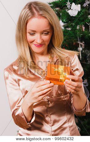 Nice woman unpacking her present