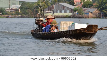 A Family Moving By Rowing Boat, The Most Common Transportation Mean