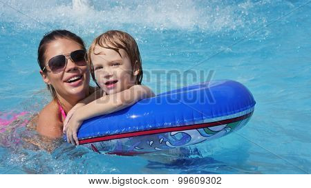 a small child with his mother in the pool