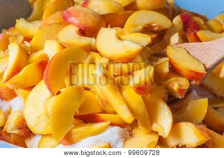 Ripe peach  fruit slice with juice. Cooking jam or marmalade background