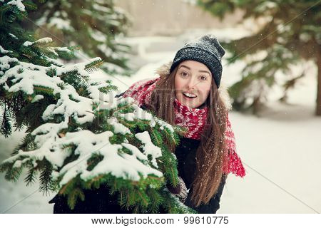 portrait of a sweet girl with a red scarf Christmas in the winter forest