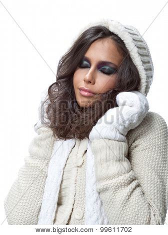 beauty face portrait of attractive young caucasian woman in warm clothing  studio shot isolated on white makeup winter christmas eyes closed