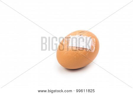 Concept Of Cracked Egg Shell With Bandage On Cracked Area.