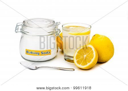 Baking Soda With Lemon Juice In Glass For Multiple Holistic Usages.