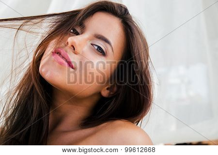 CLoseup portrait of a charming woman looking at camera