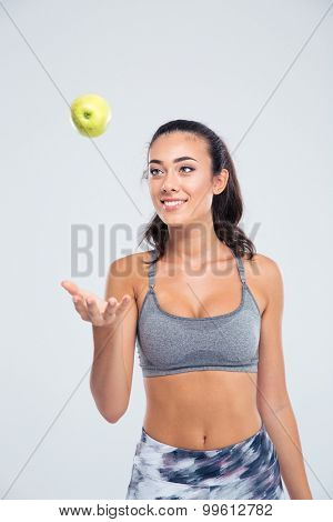 Portrait of a happy attractive woman with apple isolated on a white background