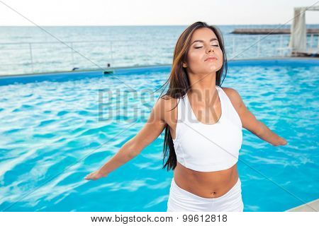 Portrait of a beautiful fitness woman working out outdoors