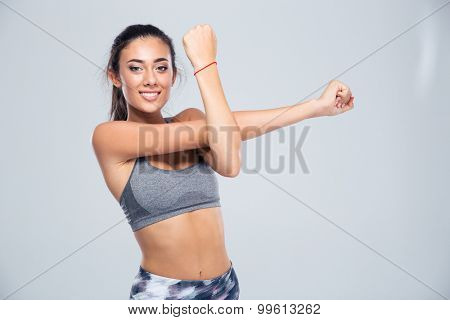 Portrait of a happy beautiful woman stretching hands isolated on a white background. Looking at camera