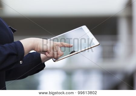 Businesswoman holding a tablet computer, closeup