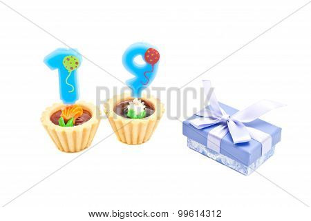 Cakes With Nineteen Years Birthday Candles And Gift On White