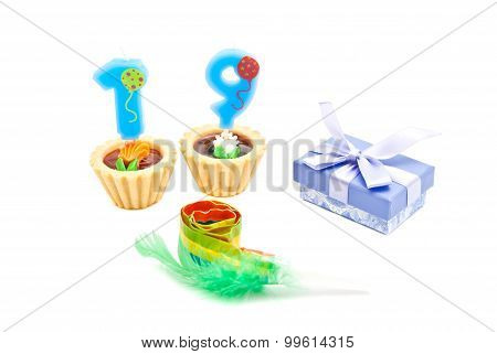 Cakes With Nineteen Years Birthday Candles, Whistle And Gift On White