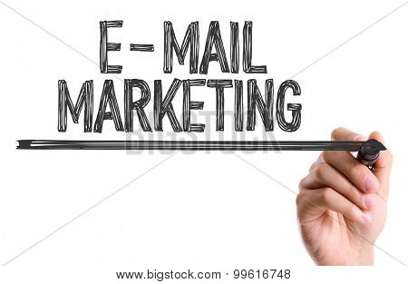Hand with marker writing the word E-Mail Marketing