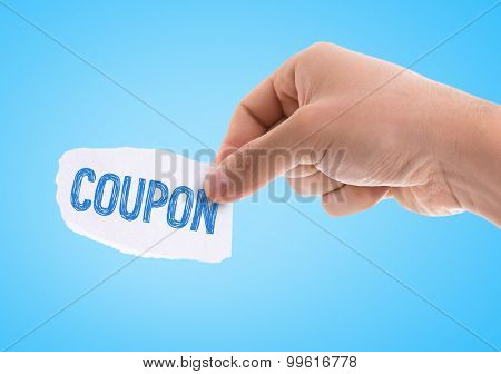 Piece of paper with the word Coupon with blue background