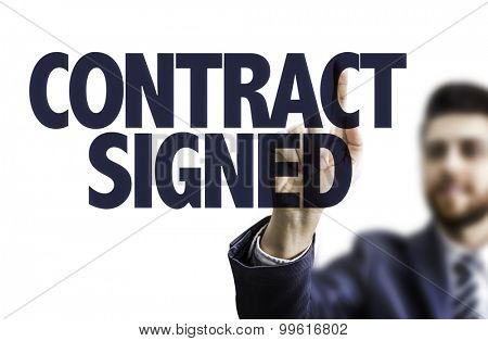 Business man pointing the text: Contract Signed