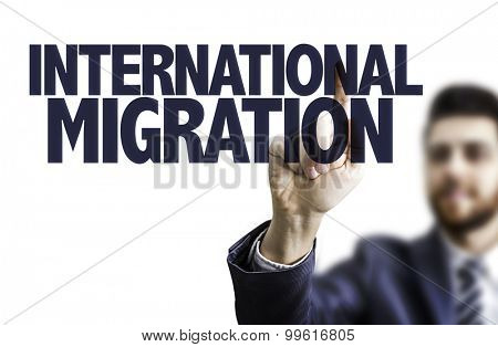 Business man pointing the text: International Migration