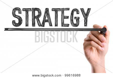 Hand with marker writing the word Strategy