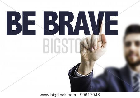 Business man pointing the text: Be Brave